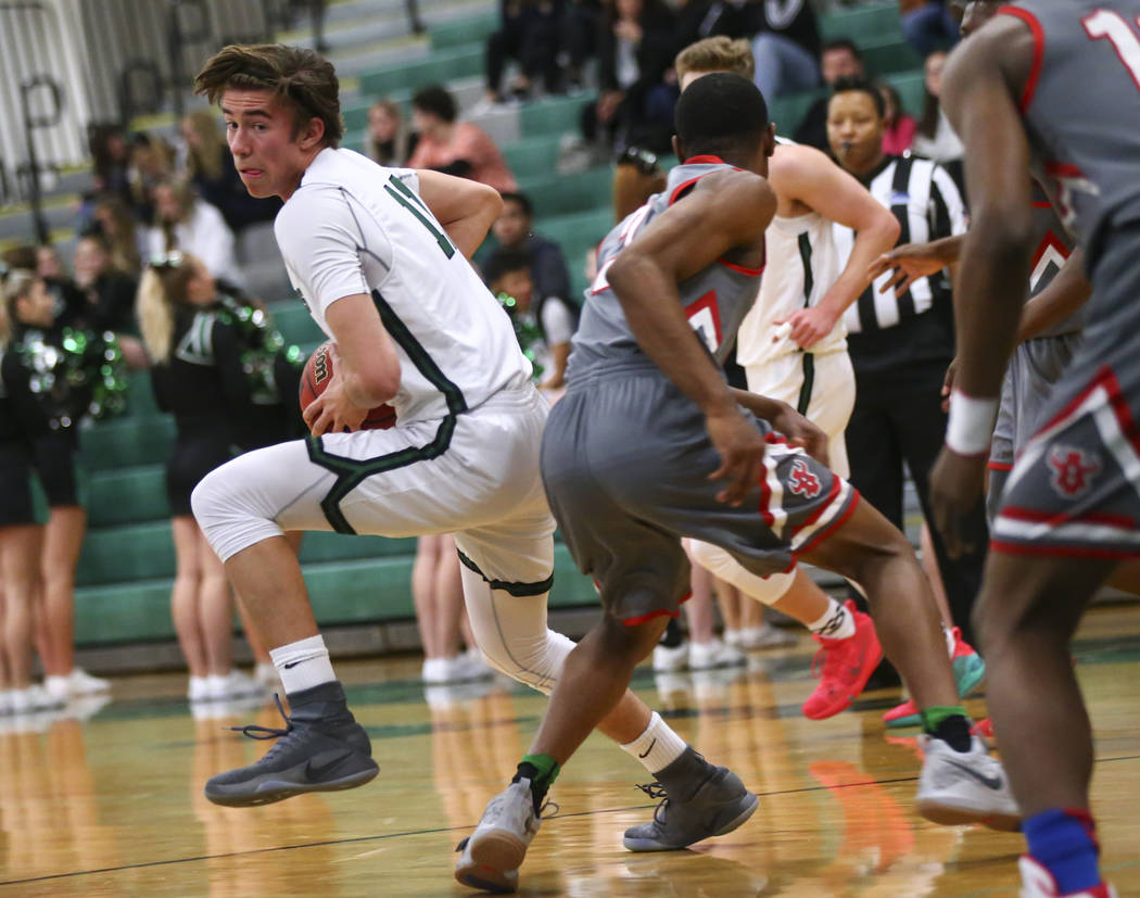 Palo Verde's Caden Loerwald (11) moves the ball around Arbor View's Favour Chukwukelu (2) during a basketball game at Palo Verde High School in Las Vegas on Thursday, Jan. 17, 2019. Chase Stevens ...