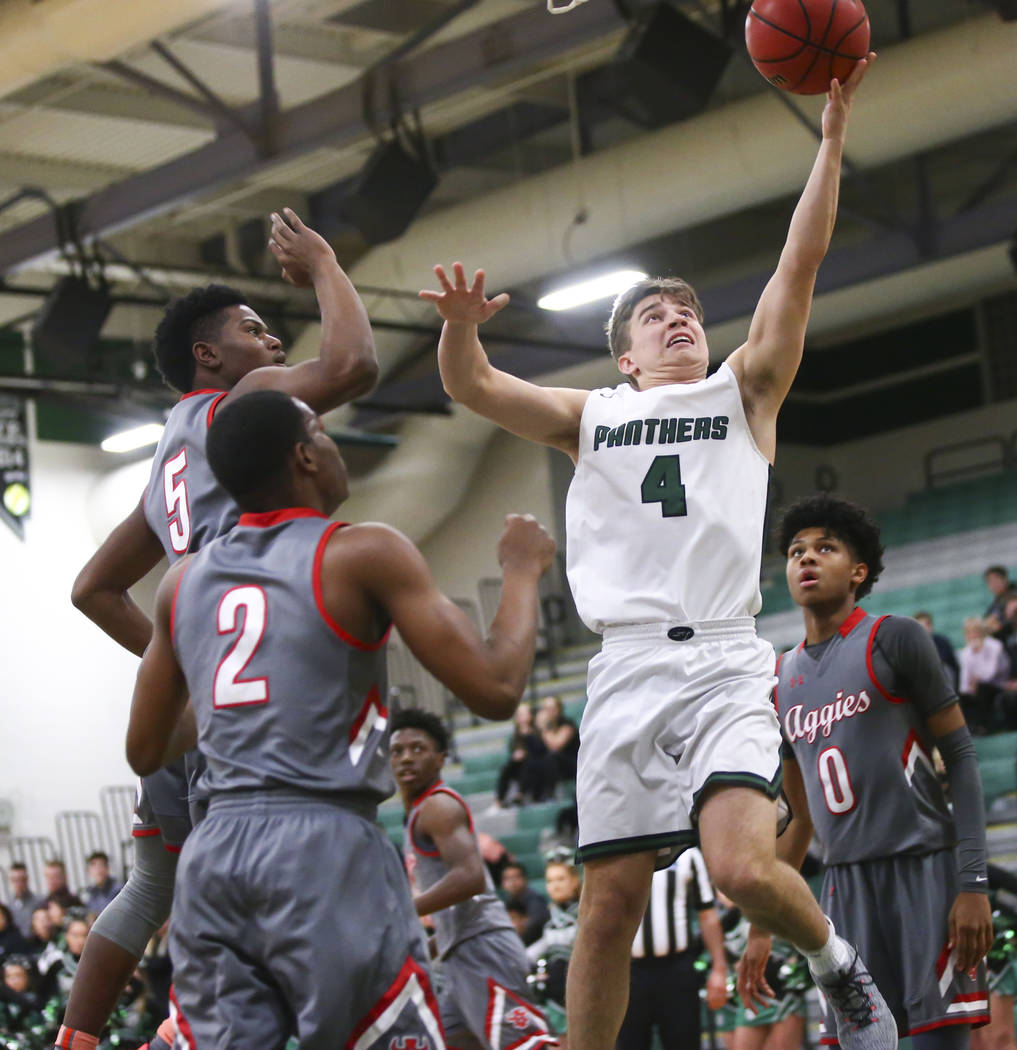 Palo Verde's Antonio Maillaro (4) goes to the basket past Arbor View's Favour Chukwukelu (2) and Adrian Armstrong (5) during a basketball game at Palo Verde High School in Las Vegas on Thursday, J ...