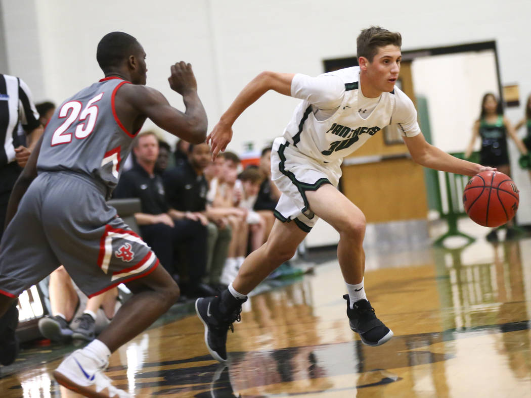 Palo Verde's Drew Warnick (30) drives the ball past Arbor View's Larry Holmes (25) during a basketball game at Palo Verde High School in Las Vegas on Thursday, Jan. 17, 2019. Chase Stevens Las Veg ...