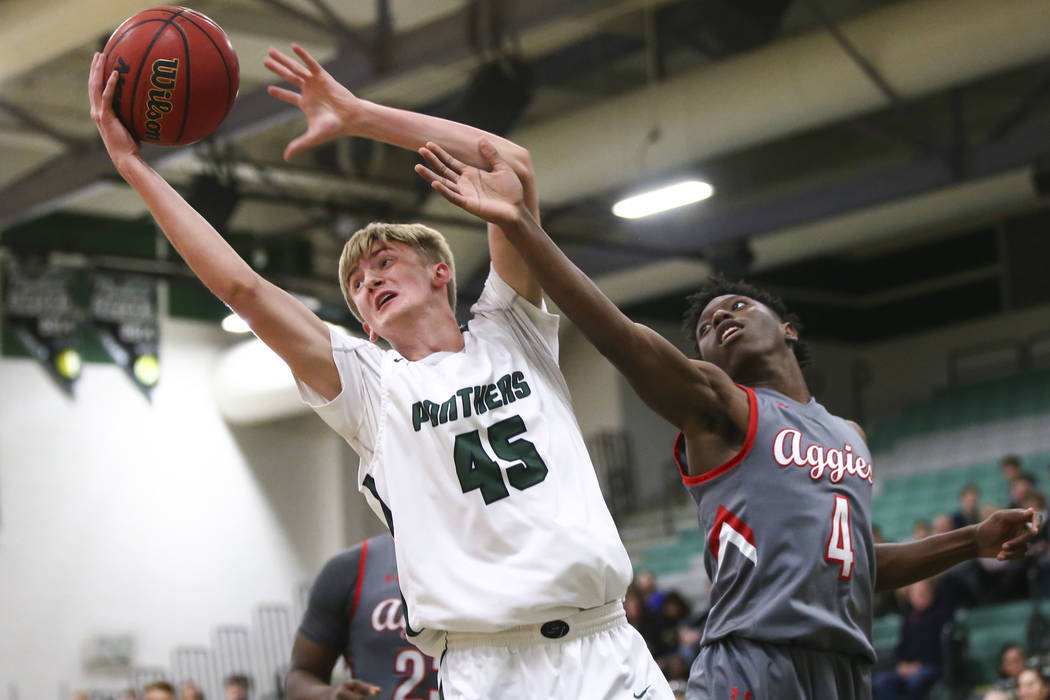 Palo Verde's Harlan Nichols (45) gets a rebound against Arbor View's Tyre Williams (4) during a basketball game at Palo Verde High School in Las Vegas on Thursday, Jan. 17, 2019. Chase Stevens Las ...