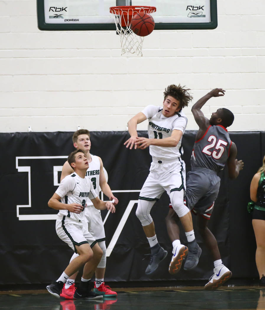 Palo Verde's Caden Loerwald (11) and Arbor View's Larry Holmes (25) battle for a rebound during a basketball game at Palo Verde High School in Las Vegas on Thursday, Jan. 17, 2019. Chase Stevens L ...