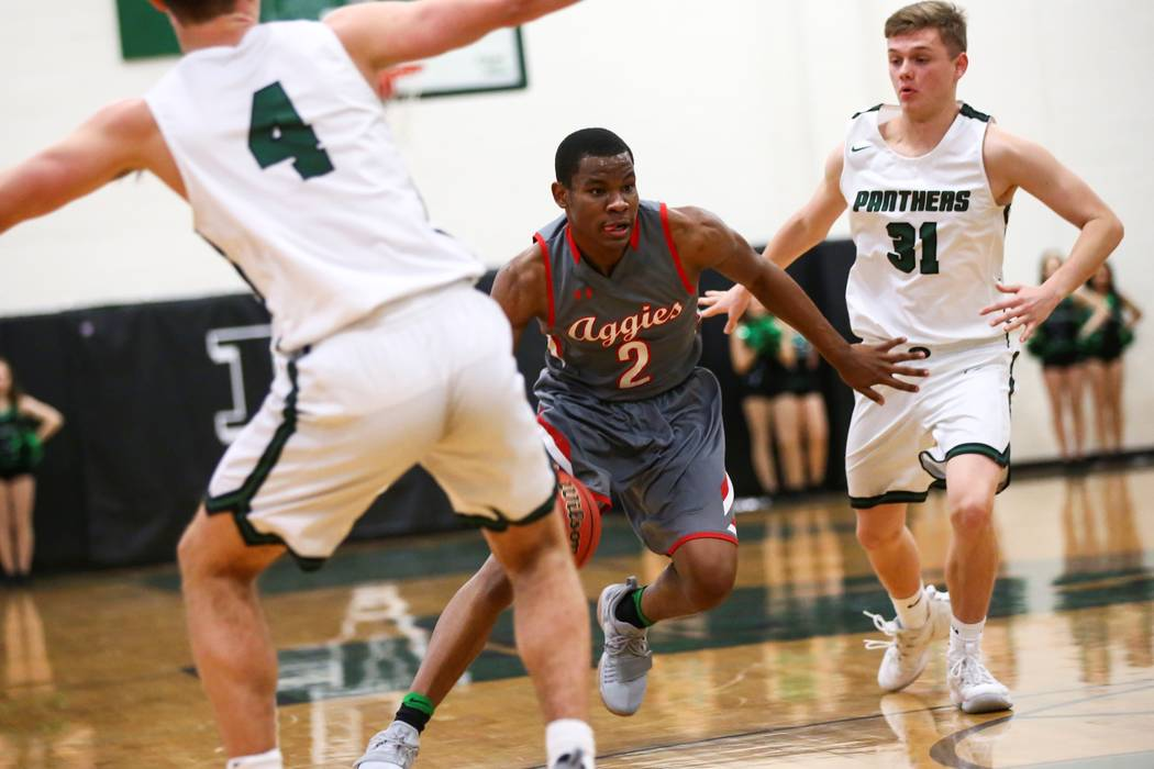 Arbor View's Favour Chukwukelu (2) drives the ball past Palo Verde's Jason Condron (31) during a basketball game at Palo Verde High School in Las Vegas on Thursday, Jan. 17, 2019. Chase Stevens La ...