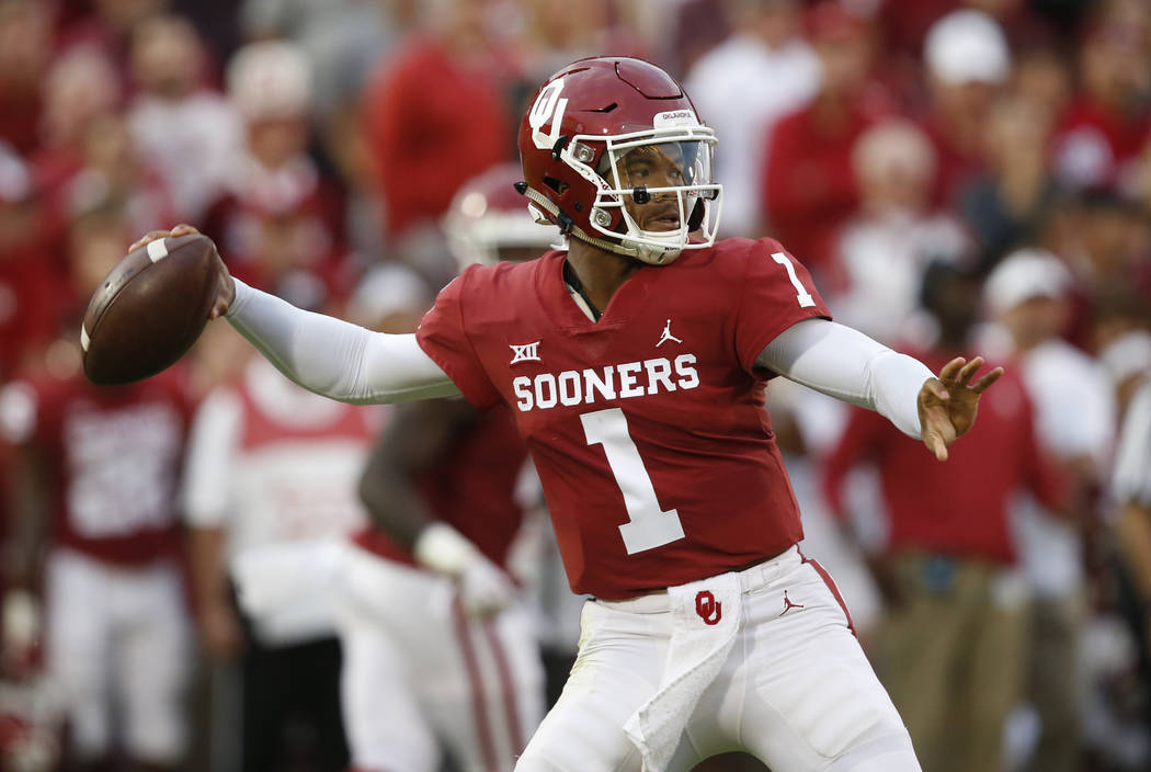 In this Sept. 22, 2018, file photo, Oklahoma quarterback Kyler Murray (1) throws in the first half of an NCAA college football game against Army, in Norman, Okla. Kyler Murray, the first-round Maj ...