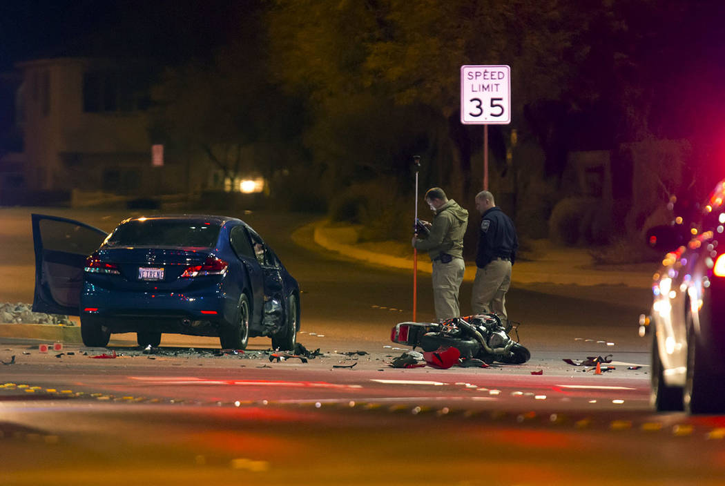 Las Vegas police and Nevada Highway Patrol investigate a fatal accident involving a motorcycle and a sedan at the intersection of at Buffalo Drive and Mountains Edge Parkway in southwest Las Vegas ...