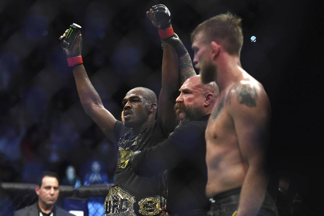 Jon Jones, left, celebrates as the referee raises his arms after Jones defeated Alexander Gustafsson in the UFC men's light heavyweight mixed martial arts bout at UFC 232, Saturday, Dec. 29, 2018, ...