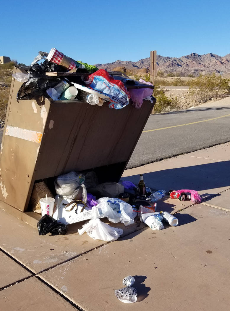 The trash can at the start of the Railroad Trail in Lake Mead National Recreation Area is overflowing with garbage as trash service is not taking place during the partial government shutdown. Othe ...