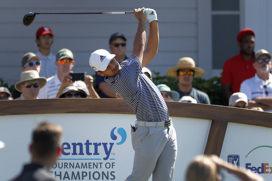 Xander Schauffele plays his shot from the first tee during the final round of the Tournament of Champions golf event, Sunday, Jan. 6, 2019, at Kapalua Plantation Course in Kapalua, Hawaii. (AP Pho ...