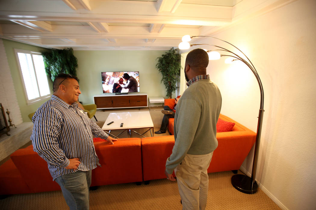 """Potential buyer Tony Redding of Las Vegas, left, talks to broker Shannon Smith at the former home of Las Vegas mobster Tony """"The Ant"""" Spilotro at 4675 Balfour Drive in Las Vegas Monday, ..."""