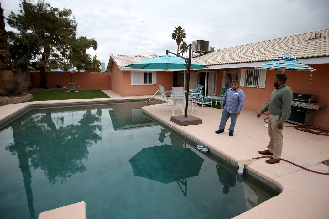 "Potential buyer Tony Redding of Las Vegas, left, talks to broker Shannon Smith at the former home of Las Vegas mobster Tony ""The Ant"" Spilotro at 4675 Balfour Drive in Las Vegas Monday, ..."