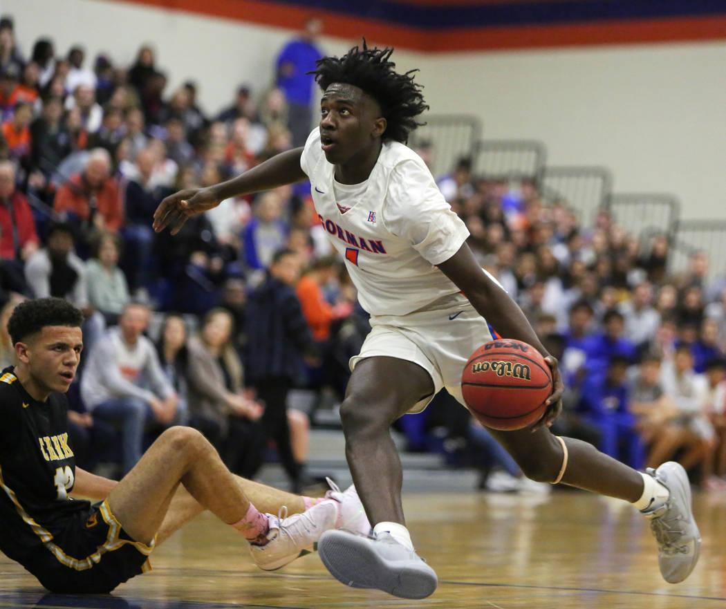 Bishop Gorman's Will McClendon (1) drives past Clark's Cameron Kimble (12) during the second half of a basketball game at Bishop Gorman High School in Las Vegas, Monday, Jan. 14, 2019. Caroline Br ...