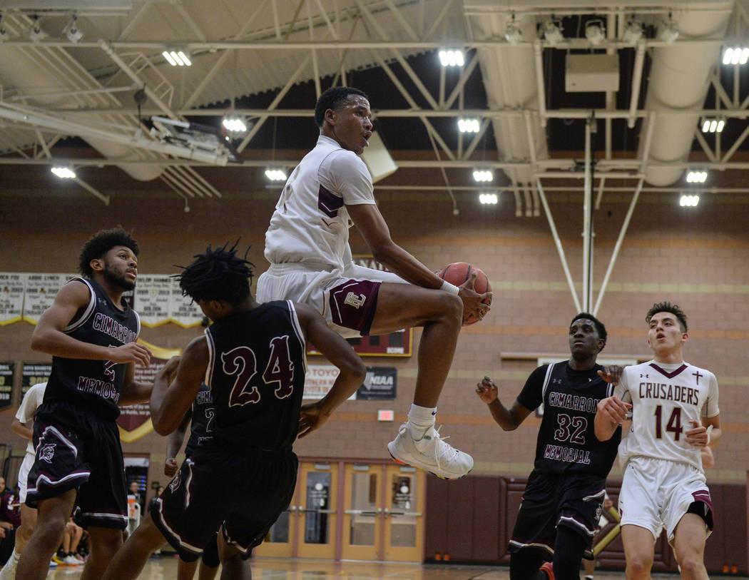 Faith Lutheran's Sedrick Hammond (4) drives the ball past Cimarron Memorial's Isaiah Profit (24) during the second half of a basketball game at Faith Lutheran High School in Las Vegas, Tuesday, Ja ...