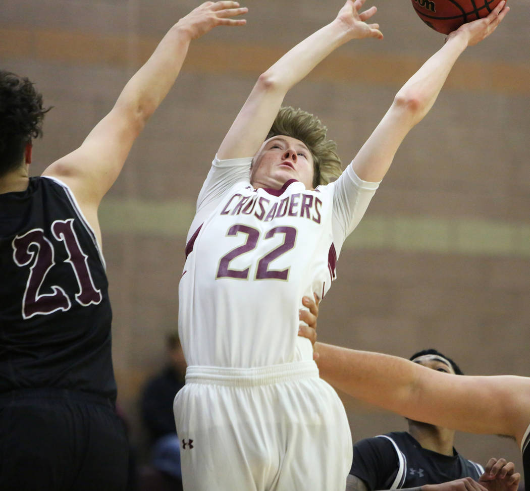 Faith Lutheran's Nick Attanasio (22) reaches for the ball while under pressure from Cimarron Memorial's Noah Do (21) during the second half of a basketball game at Faith Lutheran High School in La ...