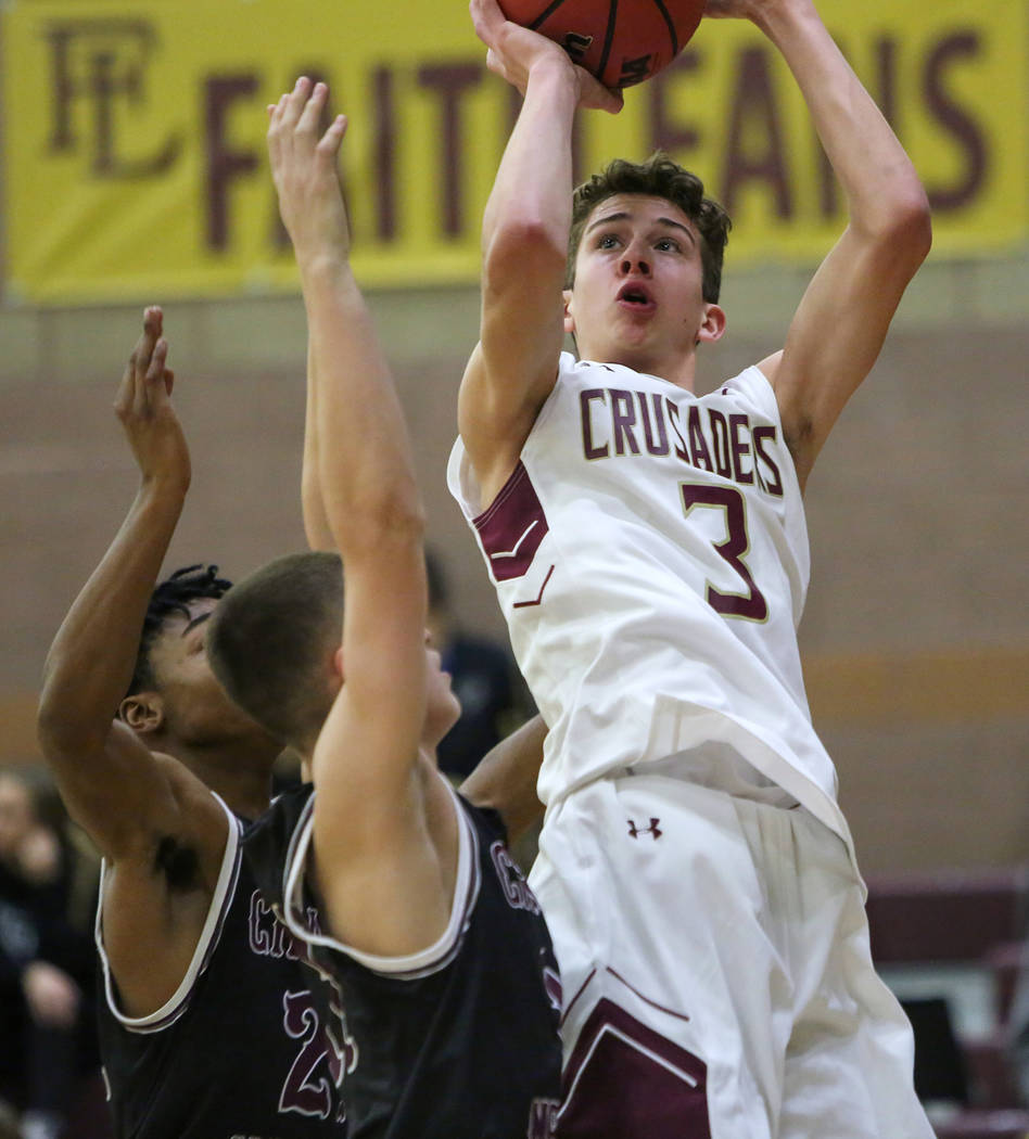 Faith Lutheran's Jason Sims (3) goes to shoot the ball while under pressure from Cimarron Memorial's Isaiah Profit (24) and Jacob Boelman (11) during the second half of a basketball game at Faith ...