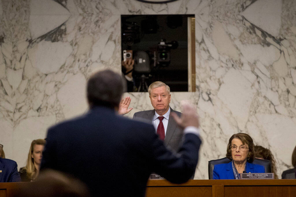 Attorney General nominee William Barr is sworn in by Senate Judiciary Committee Chairman Lindsey Graham, R-S.C., before the Senate Judiciary Committee on Capitol Hill in Washington, Tuesday, Jan. ...
