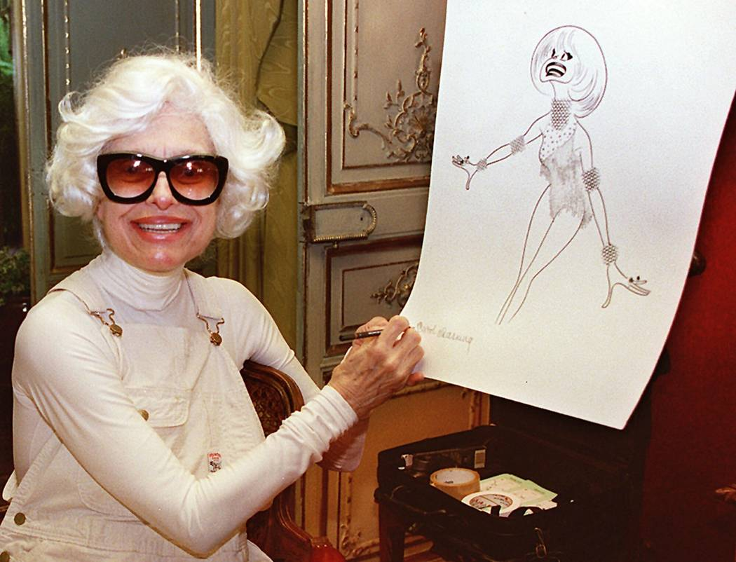 Actress Carol Channing signs a lithograph of herself by caricaturist Al Hirschfeld at her home in Beverly Hills, Calif., Nov. 1, 1997. Channing, whose career spanned decades on Broadway and on tel ...