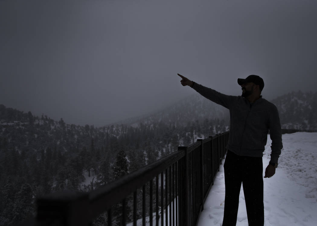 Baz M. Marshall points out a group of snowcapped mountains at Mount Charleston on Tuesday, Jan. 15, 2019, in Las Vegas. Benjamin Hager Las Vegas Review-Journal