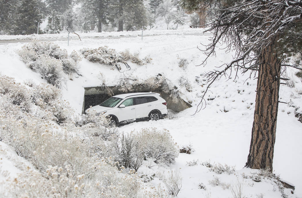 A Hyundai Santa Fe is stuck in a drainage ditch after losing control in heavy snow at Mount Charleston on Tuesday, Jan. 15, 2019, in Las Vegas. Benjamin Hager Las Vegas Review-Journal