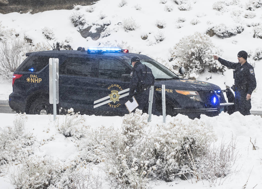 Nevada State Troopers investigate a Hyundai Santa Fe that careened into a drainage ditch at Mount Charleston on Tuesday, Jan. 15, 2019, in Las Vegas. Benjamin Hager Las Vegas Review-Journal