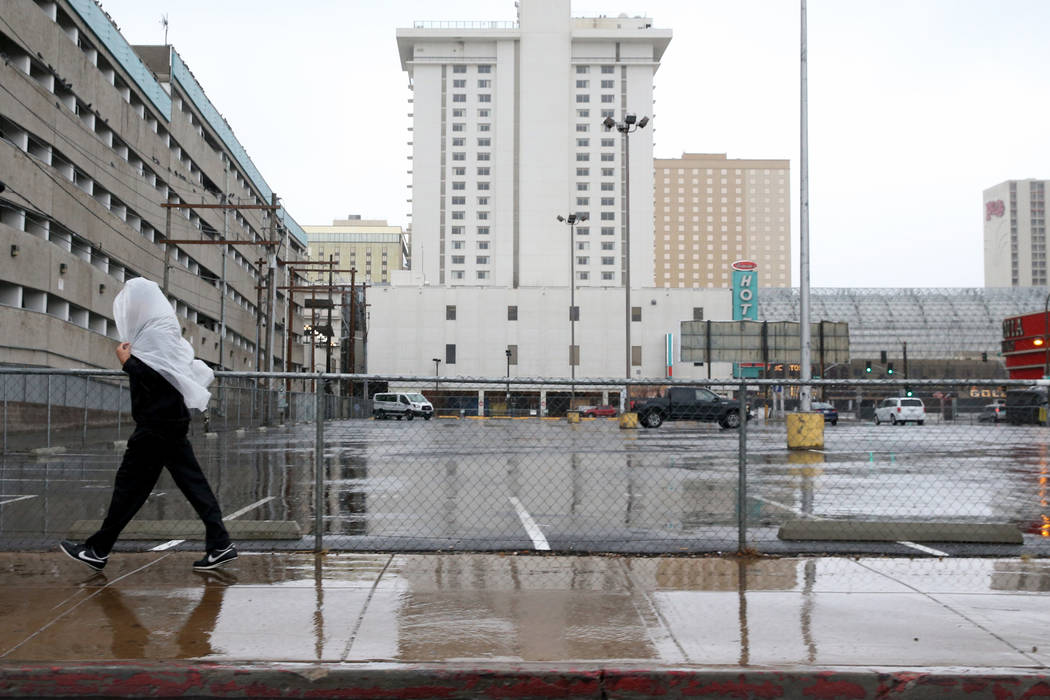 A person walks on East Ogden Avenue in downtown Las Vegas in a light rain Tuesday, Jan. 15, 2019. K.M. Cannon Las Vegas Review-Journal @KMCannonPhoto