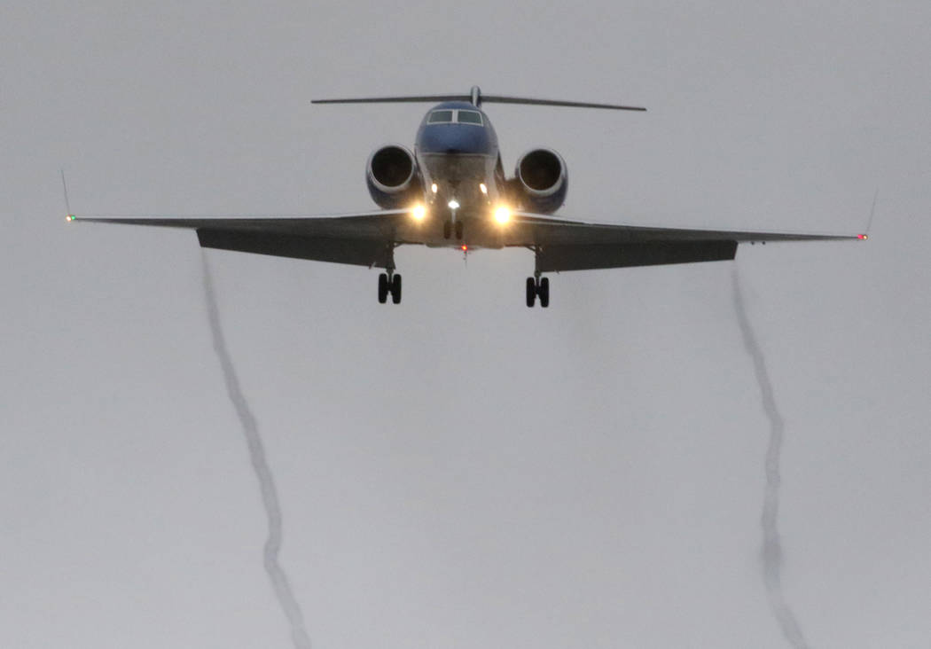 A private plane leaves smoke trails as it approaches McCarran International Airport in rainy weather on Tuesday, Jan. 15, 2019, in Las Vegas. Bizuayehu Tesfaye/Las Vegas Review-Journal @bizutesfaye