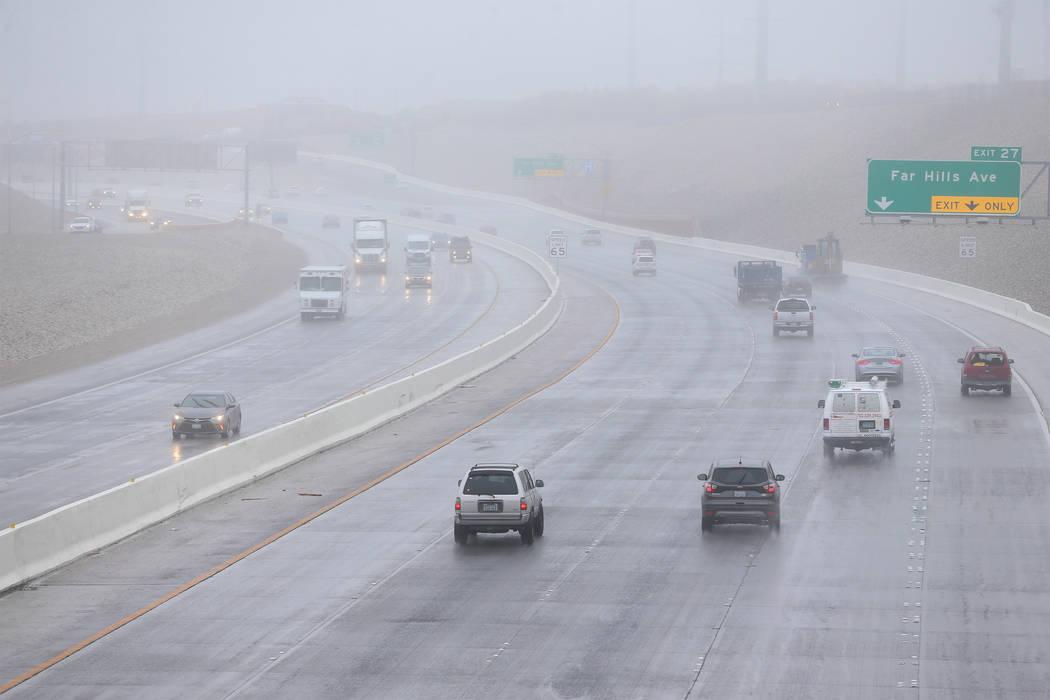 Motorists drive through fog on the 215 Beltway near Summerlin Parkway in Las Vegas, Tuesday, Jan. 15, 2019. Erik Verduzco Las Vegas Review-Journal @Erik_Verduzco