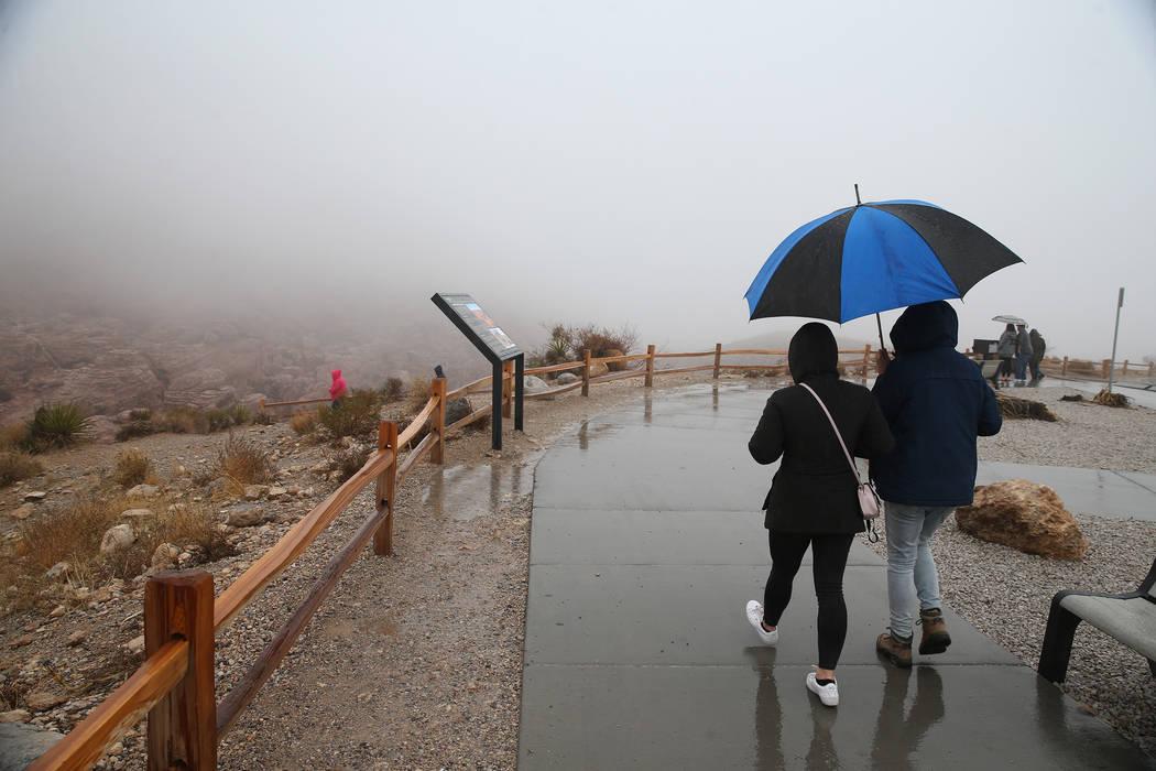 People visit the fog covered Red Rock Canyon in Las Vegas, Tuesday, Jan. 15, 2019. Erik Verduzco Las Vegas Review-Journal @Erik_Verduzco