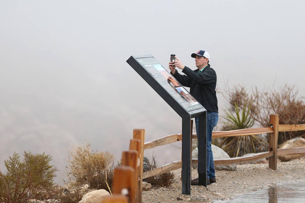 Jason Bruns of Jackson, Mo., takes a photo a Red Rock Canyon in Las Vegas, Tuesday, Jan. 15, 2019. Erik Verduzco Las Vegas Review-Journal @Erik_Verduzco