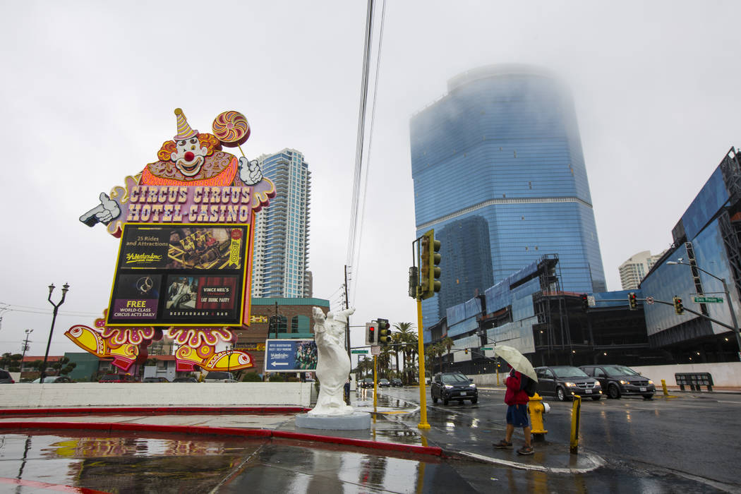 A man with an umbrella looks at the Circus Circus marquee as clouds and fog cover the Las Vegas Valley on Tuesday, Jan. 15, 2019. Chase Stevens Las Vegas Review-Journal @csstevensphoto
