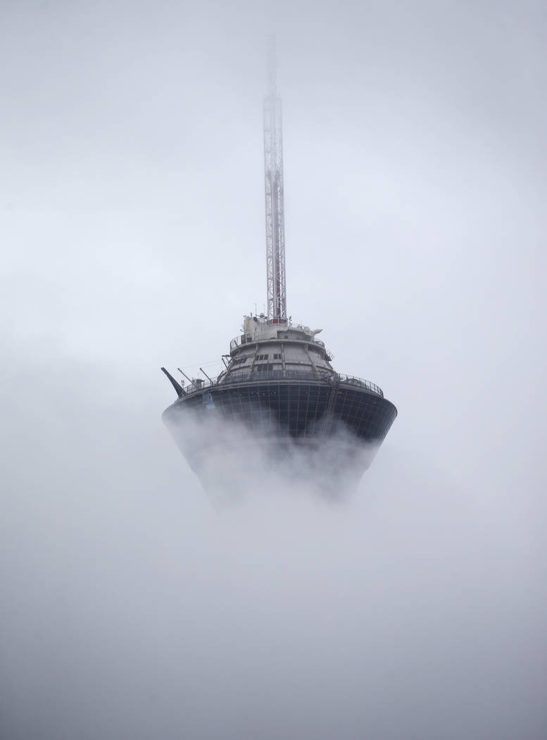 A view of the Stratosphere as clouds and fog cover the Las Vegas Valley on Tuesday, Jan. 15, 2019. Chase Stevens Las Vegas Review-Journal @csstevensphoto