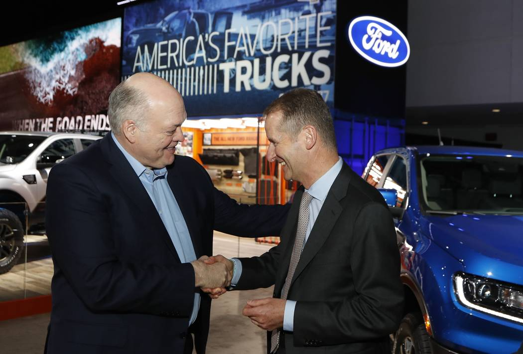 Ford Motor Co. President and CEO, Jim Hackett, left, meets with Dr. Herbert Diess, CEO of Volkswagen AG, Monday, Jan. 14, 2019, at the North American International Auto Show in Detroit. (Carlos Os ...