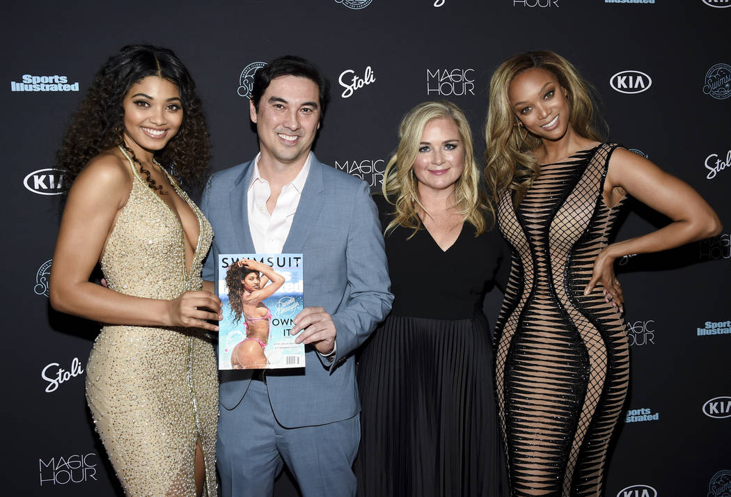 Model Danielle Herrington, from left, Sports Illustrated editor-in-chief Chris Stone, S.I. Swimsuit editor MJ Day, and model Tyra Banks attend the 2018 Sports Illustrated Swimsuit Issue launch pa ...