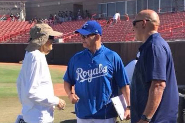 Manny Guerra, left, chats with fellow scouts Kenny Munoz of the Kansas City Royals and Mike Garcia of the Philadelphia Phillies during the Area Code baseball tryouts at UNLV's Wilson Stadium in Ju ...