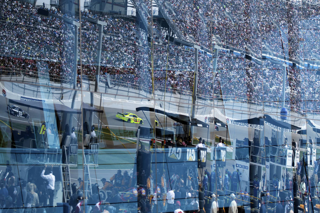 Cars are reflected in the windows of the infield media center during NASCAR Sprint Cup Kobalt Tools 400 at Las Vegas Motor Speedway Sunday, March 11, 2012. (Jason Bean/Las Vegas Review-Journal) ...