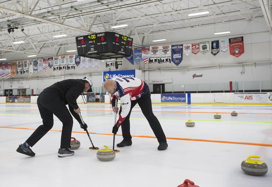Former NFL players Marc Bulger, left, and Michael Roos, members of the All Pro Curling Team, compete in a curling tournament at the Las Vegas Ice Center in Las Vegas on Friday, Jan. 11, 2019. Chas ...