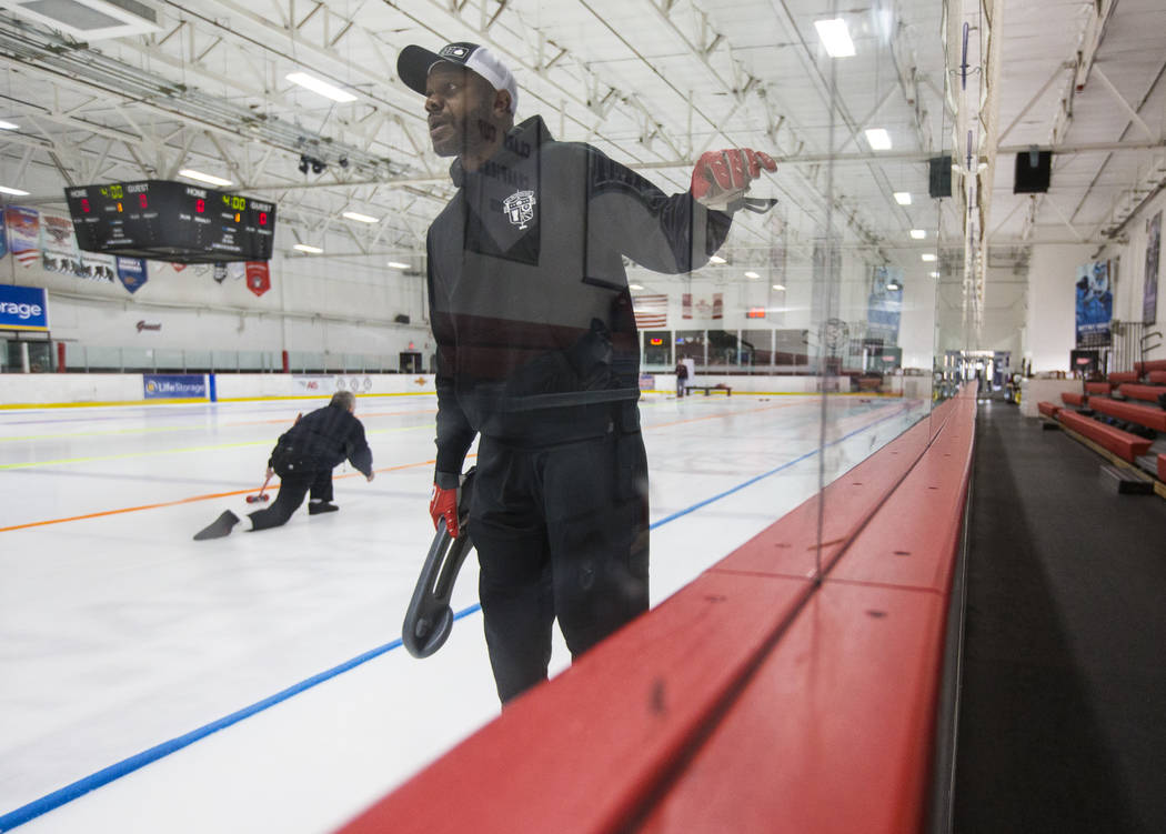 Former NFL player Keith Bulluck, a member of the All Pro Curling Team, warms up before competing in a curling tournament at the Las Vegas Ice Center in Las Vegas on Friday, Jan. 11, 2019. Chase St ...