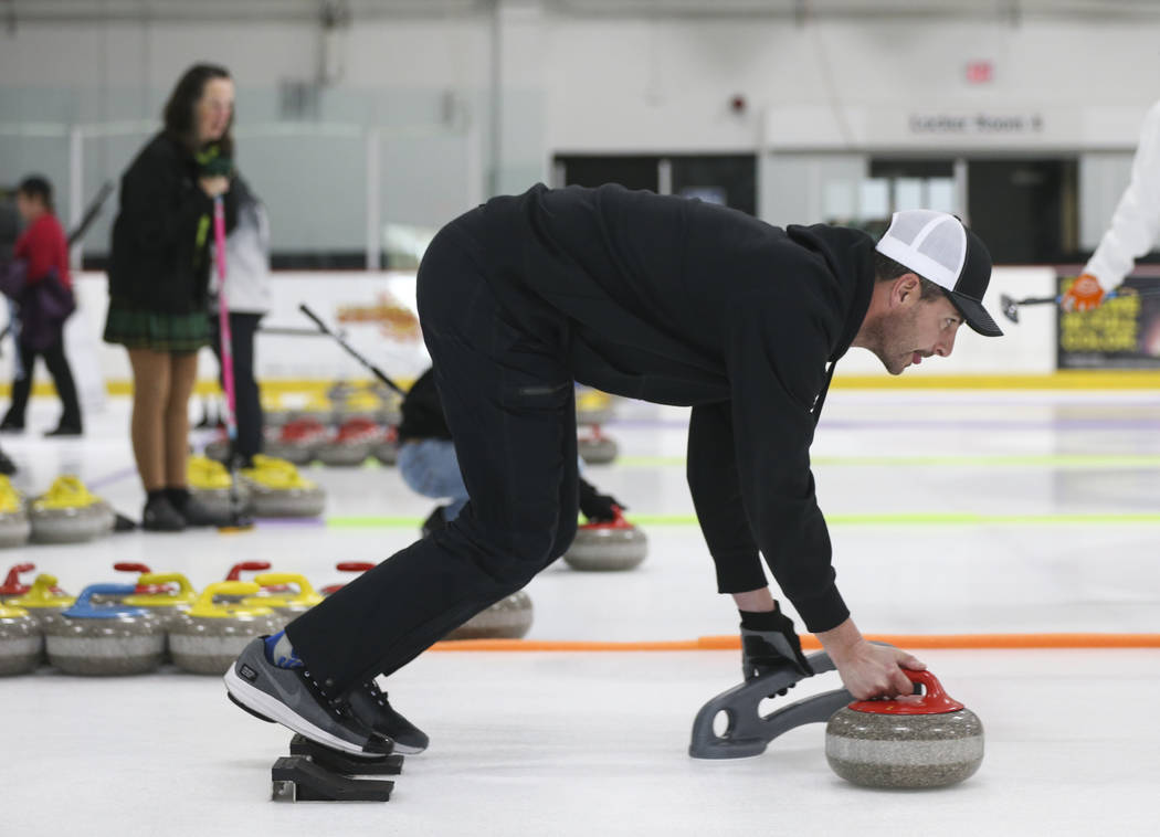 Former NFL quarterback Marc Bulger, a member of the All Pro Curling Team, warms up before competing in a curling tournament at the Las Vegas Ice Center in Las Vegas on Friday, Jan. 11, 2019. Chase ...
