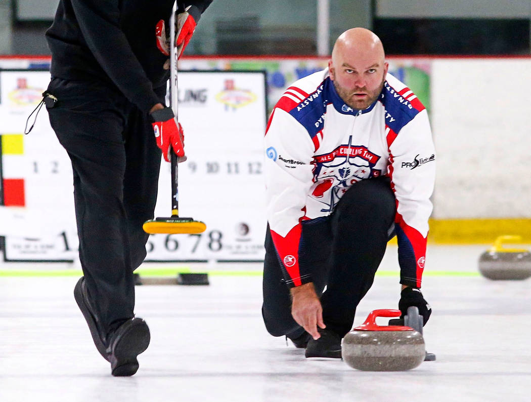 Former NFL players Keith Bulluck, left, and Michael Roos, members of the All Pro Curling Team, compete in a curling tournament at the Las Vegas Ice Center in Las Vegas on Friday, Jan. 11, 2019. Ch ...