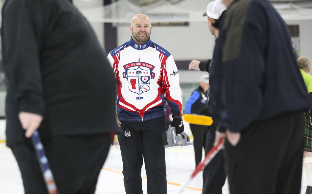 Former NFL player Michael Roos, a member of the All Pro Curling Team, talks with a teammate while competing in a curling tournament at the Las Vegas Ice Center in Las Vegas on Friday, Jan. 11, 201 ...