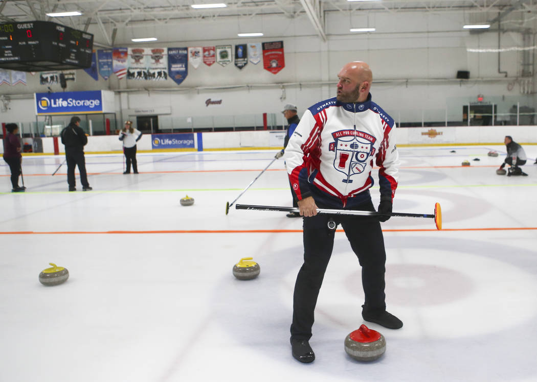 Former NFL player Michael Roos, a member of the All Pro Curling Team, competes in a curling tournament at the Las Vegas Ice Center in Las Vegas on Friday, Jan. 11, 2019. Chase Stevens Las Vegas Re ...