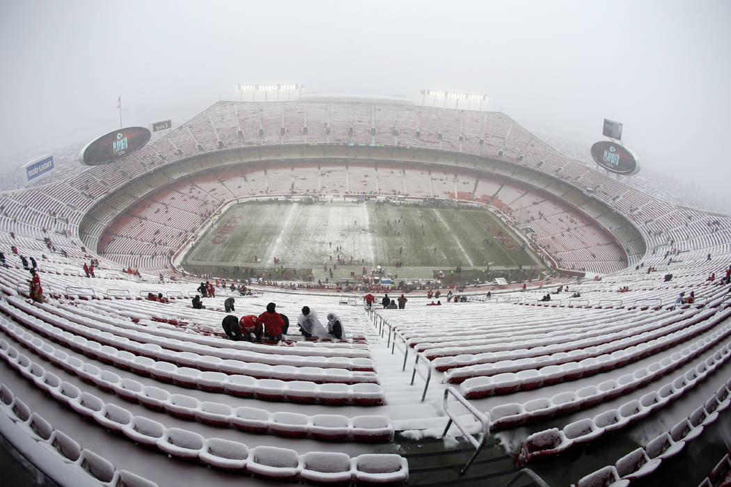 Fans arrive at a snow covered Arrowhead Stadium before an NFL divisional football playoff game between the Kansas City Chiefs and the Indianapolis Colts, in Kansas City, Mo., Saturday, Jan. 12, 20 ...