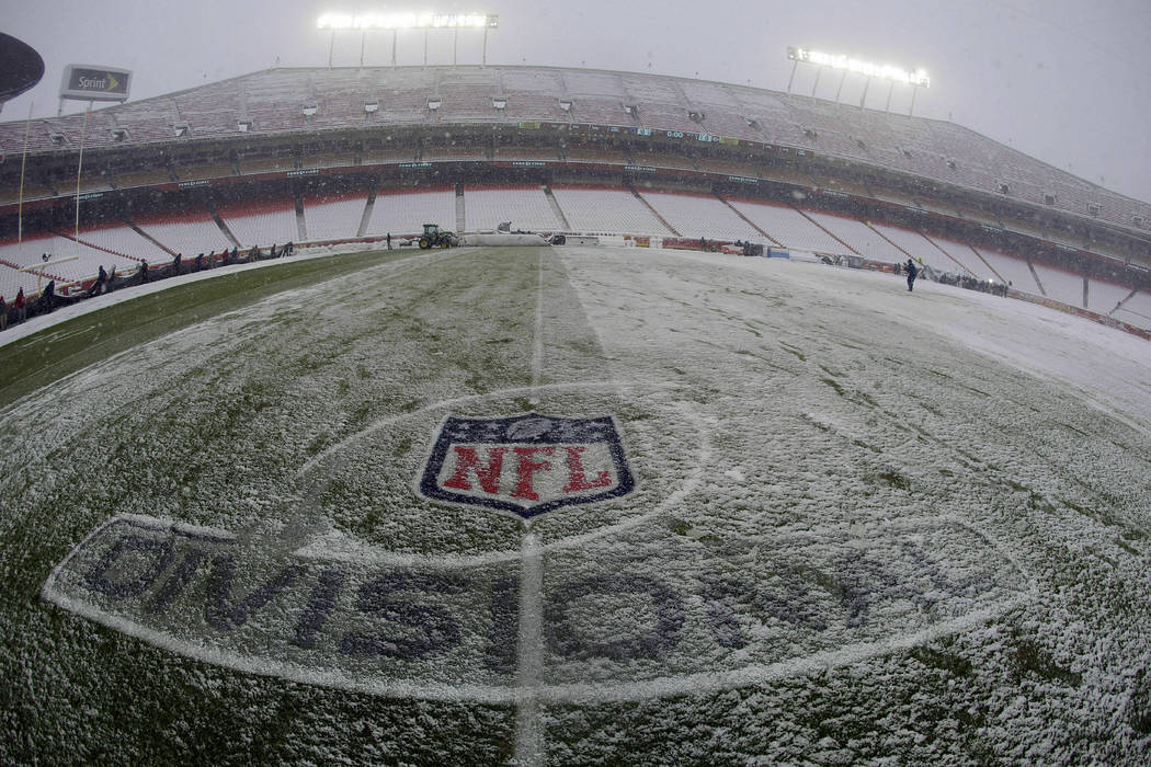 Snow covers the playing field at Arrowhead Stadium before an NFL divisional football playoff game between the Kansas City Chiefs and the Indianapolis Colts in Kansas City, Mo., Saturday, Jan. 12, ...