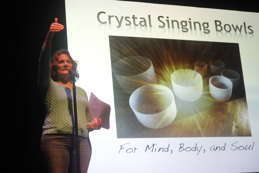 Diondra, performing arts center director at Summerlin Library, shares a few words at Crystal Singing Bowls, a free presentation in the library's theater on Saturday that included the detailed hist ...