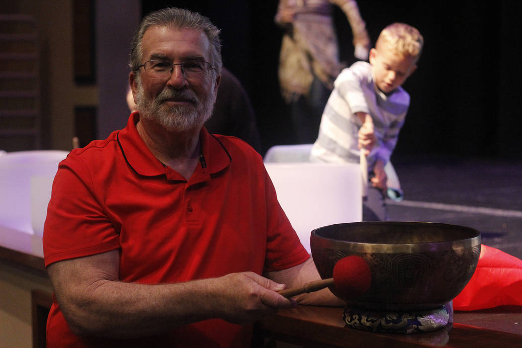 Chuck Stinnett is pictured beside the singing bowl he bought in Nepal. The bowl is engraved with chants from monks in that area, he said. (Mia Sims/Las Vegas Review-Journal @miasims___)