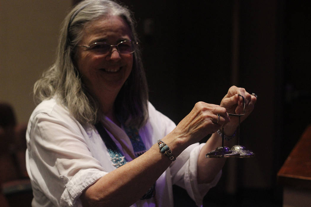 Frances Meyer, a healing touch practitioner who performed at the Crystal Singing Bowls event alongside Ann Vanoy holds tingsha bells, used for mediation. (Mia Sims/Las Vegas Review-Journal @miasim ...