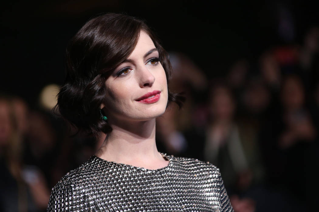 Actress Anne Hathaway poses for photographers upon arrival at the premiere of the film Interstellar, in central London, Wednesday, Oct. 29, 2014. (Joel Ryan/Invision/AP)