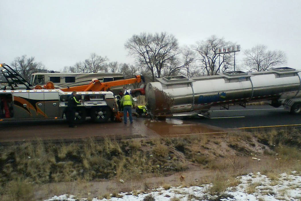 The scene of a crash about 11 miles east of Flagstaff, Ariz. on Monday, Jan. 14, 2019. A tank trucker's trailer detached from the truck and rolled on its side on slick pavement, spilling a rive ...