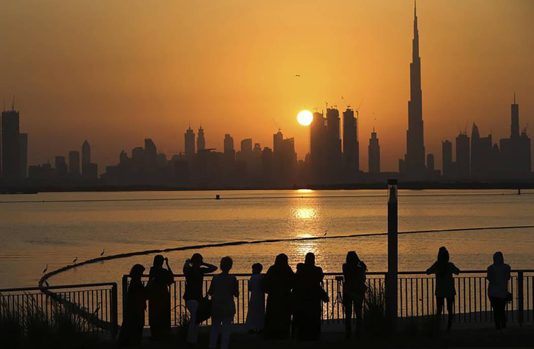People watch the sun set over the Dubai skyline in October 2016. (AP file)