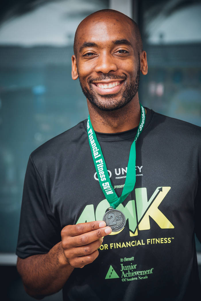 Michael Crome shows off his second-place medal after finishing the first Junior Achievement of Southern Nevada 4.01k Race for Financial Fitness. (Junior Achievement of Southern Nevada)