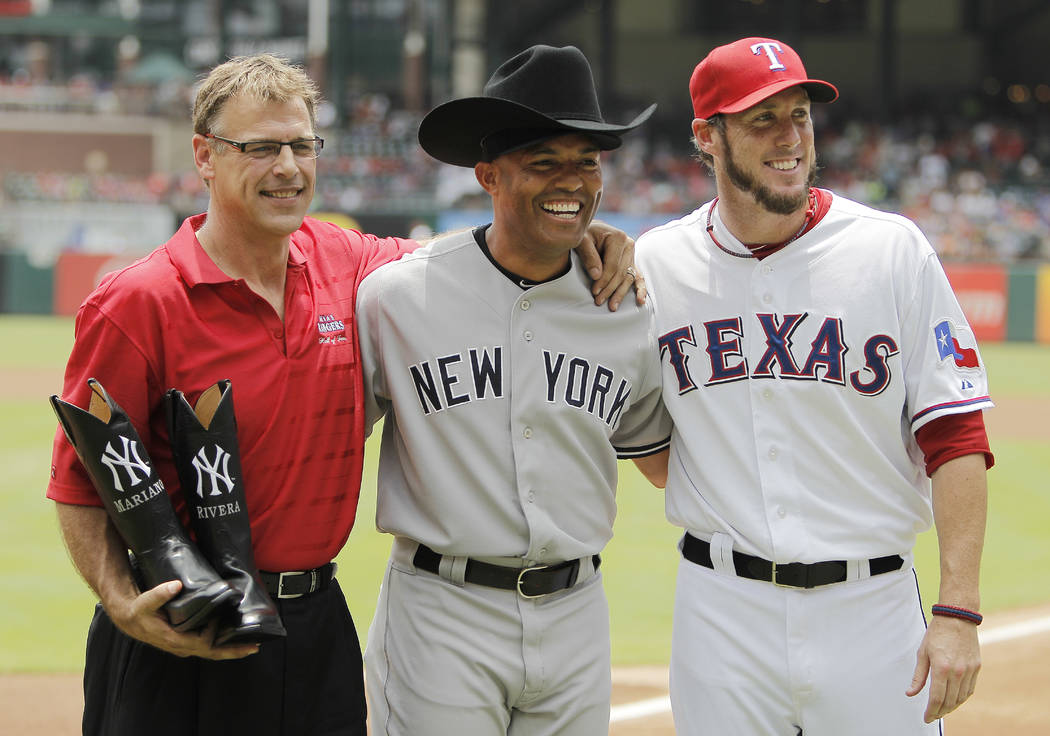 This July 25, 2013 file photo shows former Texas Rangers closer John Wetteland, left, and Rangers relief pitcher Joe Nathan, right, posing for a photo with New York Yankees relief pitcher Mariano ...