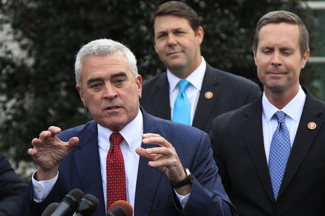 Rep. Brad Wenstrup, R-Ohio, joined by Rep. Rodney Davis, R-Ill., right and Rep. Jodey Arrington, R-Texas, center, speaks to reporters outside the West Wing following a meeting with President Donal ...